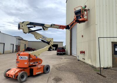 Boom lift outside warehouse.