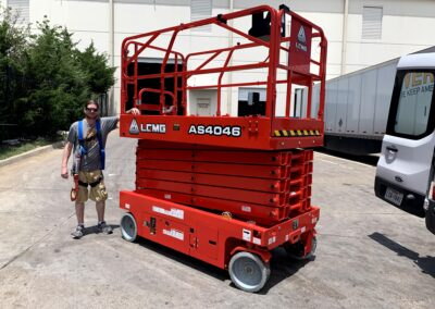 A man with his scissor lift... a beautiful thing!